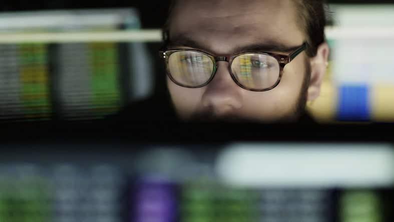 man looking at his computer screen