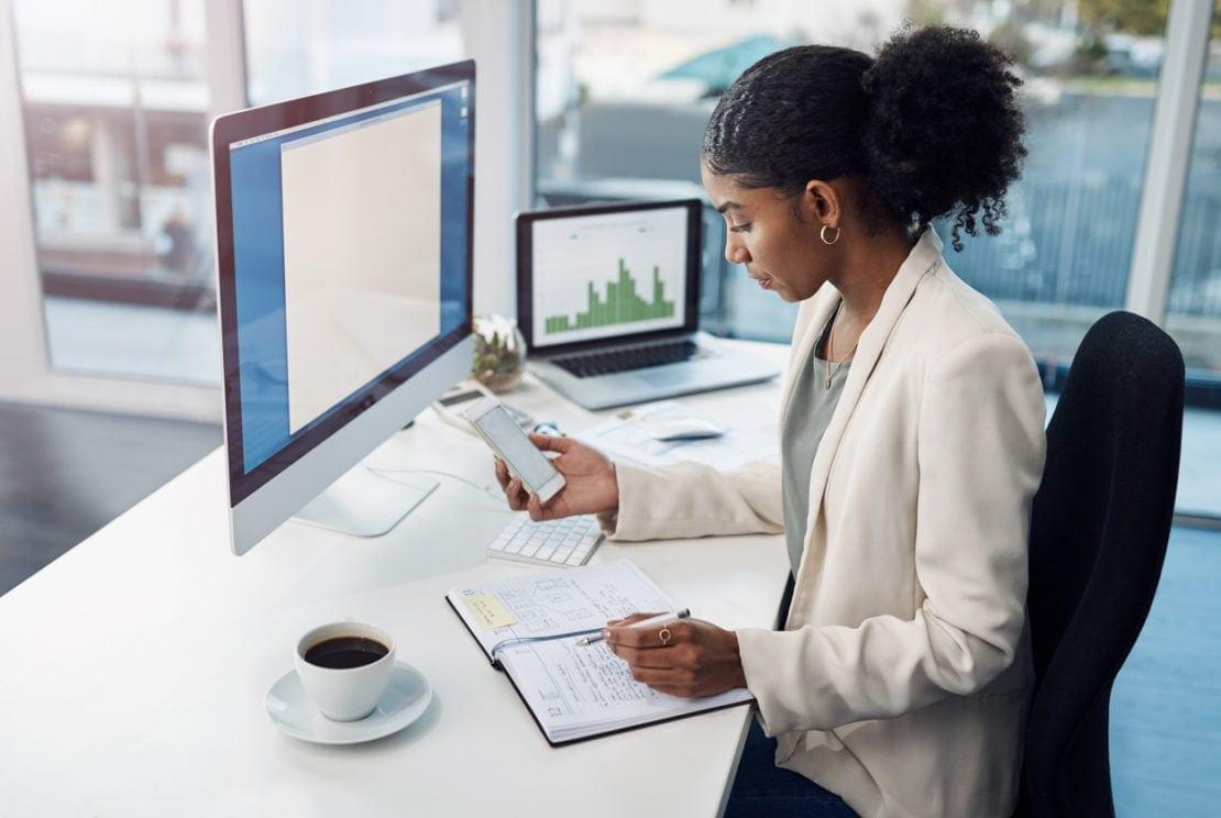 businesswoman sat at her desk