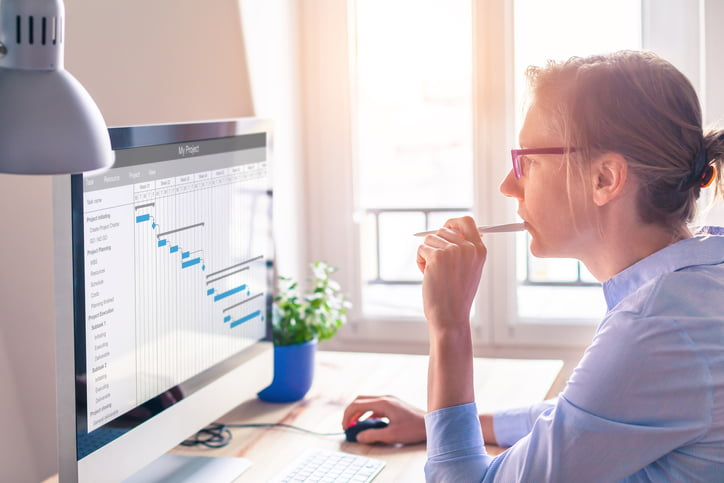 woman looking at data on her computer screen