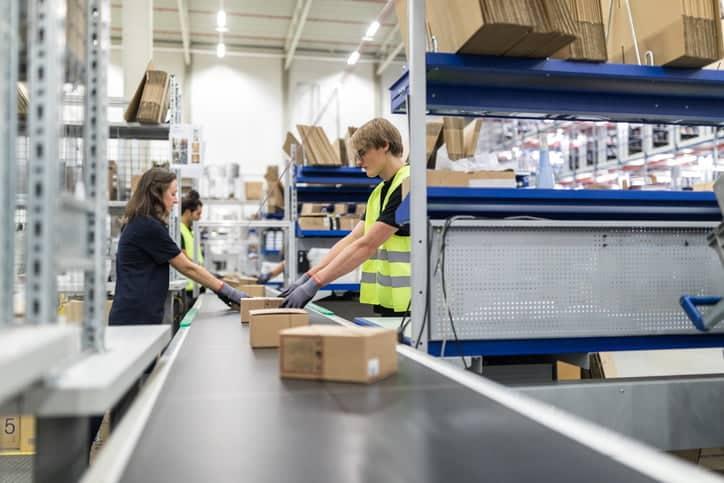 warehouse workers at conveyor belt