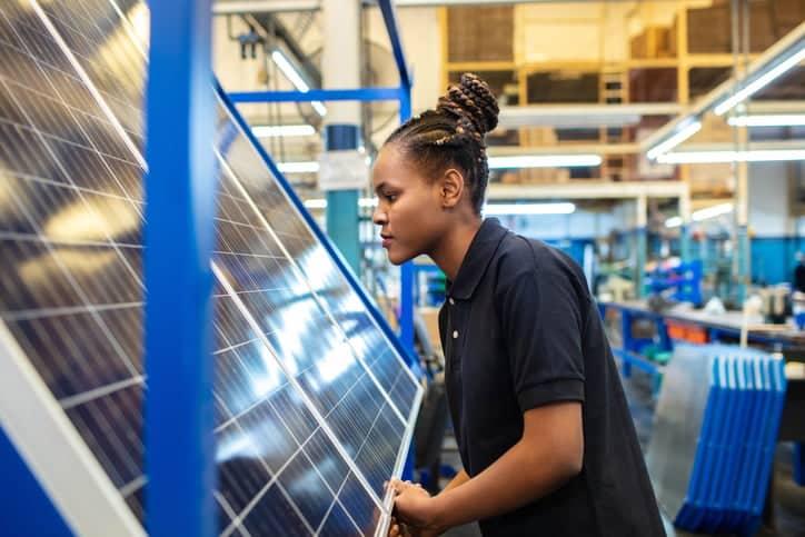 engineer looking at solar panels